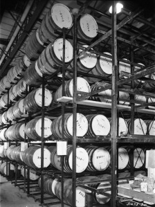 Oak barrels of ginger ale extract in the aging room, c. 1954