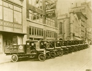 Delivery trucks in front of bottling plant on Woodward Ave, c. 1920