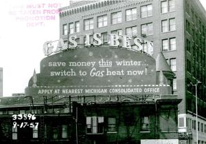 1957, ornate cornice of the Michigan Consolidated Gas Co. Building in the background.