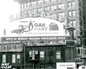 1958, Michigan Consolidated Gas Co. Building likely having its cornice removed.