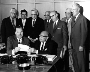 Mayor Jerome Cavanagh receives Stanley S. Kresge's pledge.