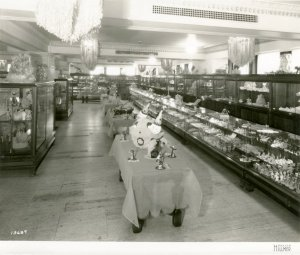 Also from the 1920s, this photo from the Davis Hillmer Collection shows retail displays dressed with clown papier-mâché centerpieces and skeleton place holders, and stocked with edible and ornamental treats.
