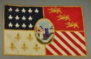 This needlepoint interpretation of the flag of the city of Detroit was made in 1976, by Helen Coutts, a retired English teacher from Redford High School and a member of the Detroit Historical Society Guild.