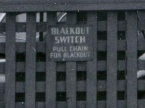 1943, detail of blackout switch on a war bonds advertisement as a precaution for enemy air raids.