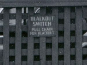 1943, detail of blackout switch on a war bonds advertisement as a precaution for enemy air raids.