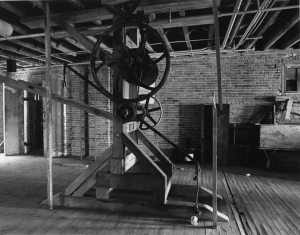 Tannery equipment remained in place until redevelopment began, like this hoist on the 4th floor (Carmen Truice, 1982).