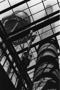 Preserved water tower and smokestack seen through the sky-roof (Carmen Truice, 1982).