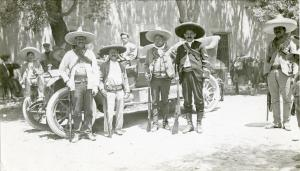 Mexican revolutionaries standing next to a Packard, c. 1915.