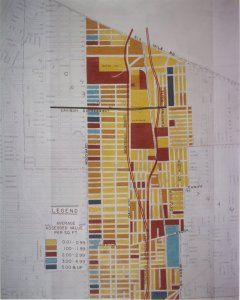 In 1956 plans were being finalized for the construction of the Chrysler Freeway (I-75) in Detroit. This photo of a map shows two proposed routes for the expressway, comparing the assessed land values south of Six Mile Road.