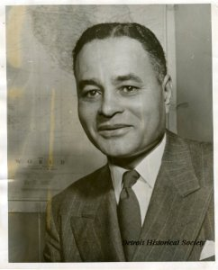 Dr. Ralph J. Bunche poses in front of a world map in this c. 1950 portrait.