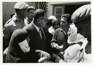 Under-Secretary Bunche and several members of the United Nations Peace-Keeping Force in Cyprus meet with residents of Ktima on April 9, 1964.