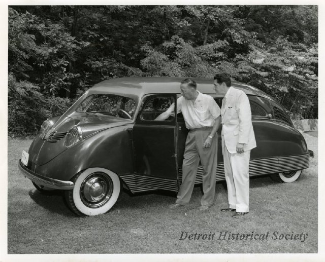 Philip K. Wrigley shows his Stout Scarab to Henry D. Brown, Director of the Detroit Historical Society (1964).