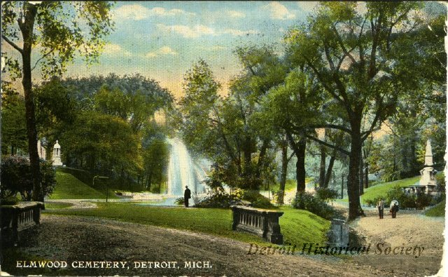 A tranquil scene from Detroit's Elmwood Cemetery decorates this 1914 postcard.