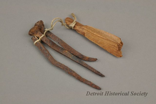 These three rustic-looking nails and this scrap of wood were donated along with the key. They were said to have been from Lewis Cass' home.