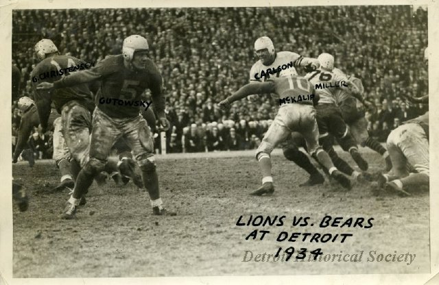 Photo depicting a play during the November 29, 1934 Lions vs. Bears game. Lions players include #14 George Christensen and #5 Ace Gutowsky.